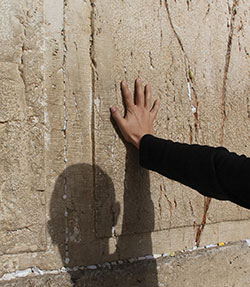 Photo: hand on the Western Wall.